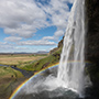 Waterfall with rainbow at basin © Nikhil Bahl